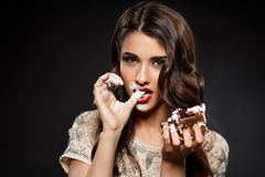 Sexy woman in creamy dress holding piece of cake Stock Image