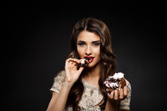 Sexy woman in creamy dress holding piece of cake Stock Images