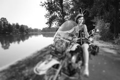 Sexy woman on cruiser motorcycle near the lake Royalty Free Stock Photos