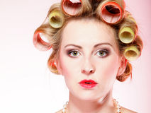 Sexy woman curlers in hair preparing to party Stock Images