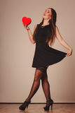 Sexy woman dancing with heart. Beauty, sexuality and seductiveness. Young attractive sexy full lenght woman model with red heart box gift present dancing in Royalty Free Stock Photography