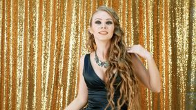Woman dancing party gold glitter background stock video footage
