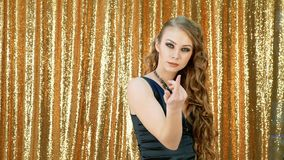 Woman dancing party gold glitter background stock video