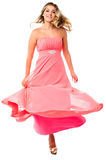 Sexy woman dancing and swirling in party dress Stock Photo