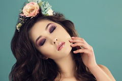 Sexy woman with dark hair and bright makeup with flower's headband Royalty Free Stock Images