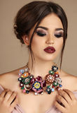 Sexy woman with dark hair and bright makeup, with necklace Royalty Free Stock Images