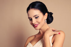 Sexy woman with dark hair with evening makeup and bijou Royalty Free Stock Photos