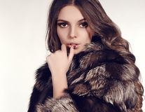 Sexy woman with dark hair in luxurious fur coat Royalty Free Stock Photo