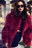 Sexy woman with dark hair in luxurious fur coat and sunglasses Royalty Free Stock Image