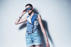 Sexy woman in denim waistcoat and sunglasses Stock Photos