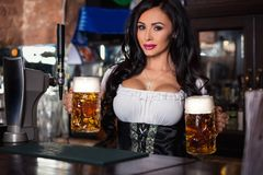 woman in dirndl dress holding Oktoberfest beer stein. royalty free stock photo