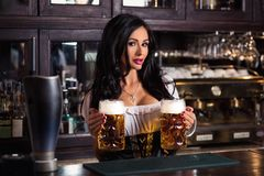woman in dirndl dress holding Oktoberfest beer stein. stock photography