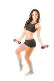 Woman does exercise with dumbbells. Young woman in sports bra does exercise with dumbbells on white background Fitness royalty free stock photo