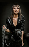 Sexy woman with dog Stock Photography