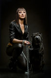 Sexy woman with dog Royalty Free Stock Image