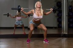 Sexy Woman Doing Exercise Barbell Squat Royalty Free Stock Photos