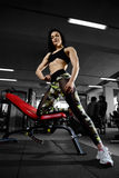 Sexy woman doing exercises in gym Royalty Free Stock Image
