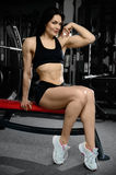 Sexy woman doing exercises in gym Royalty Free Stock Photo