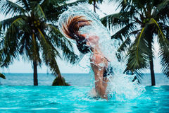 Sexy woman doing hairflip in swimming pool Stock Photography