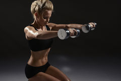 Sexy woman doing physical exercise Royalty Free Stock Images