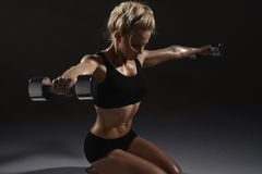 Sexy woman doing physical exercise. With dumbbells Stock Photos