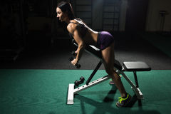 woman doing workout with dumbbells in gym stock photos