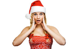 Sexy woman dressed as Santa Claus. On a white background Royalty Free Stock Image