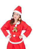 Sexy woman dressed as Santa Claus looking at right on a white ba Stock Photo