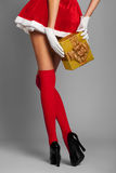 woman dressed in christmas red dress with gift box Royalty Free Stock Photos