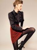 woman dressed elegant doing a fashion shoot Stock Image