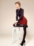 Sexy woman dressed elegant doing a fashion shoot Stock Photos