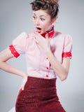 Sexy woman dressed retro doing a pin-up fashion shoot Stock Photo
