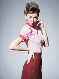 Sexy woman dressed retro doing a pin-up fashion shoot Stock Photos