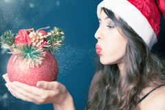 woman dressed in Santa Claus clothes holding Christmas toy. Royalty Free Stock Photography