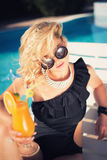 Sexy woman drinking cocktail Stock Images