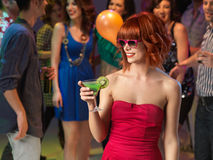 Sexy woman drinking cocktail in night club. Sexy, young women drinking a cocktail on the dancefloor, in a night club Stock Photos