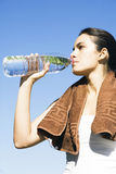 Sexy woman drinking water after exercise Stock Images
