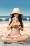 Sexy woman drinks coconut water Royalty Free Stock Image