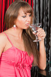 Sexy woman drinks Martini in bar Royalty Free Stock Image