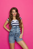Sexy Woman In Dungarees Royalty Free Stock Photography