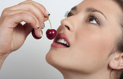 Sexy woman eating cherries Royalty Free Stock Photos