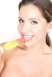 Sexy woman eating popsicle Royalty Free Stock Photo