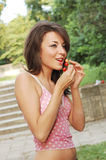 Sexy woman eating ripe cherry Stock Image