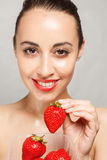 Sexy Woman Eating Strawberry. People, emotions, natural, food, beauty and lifestyle concept - Sexy Woman Eating Strawberry. Sensual Lips. Manicure and Lipstick Royalty Free Stock Photo