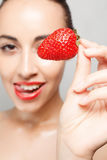 Sexy Woman Eating Strawberry. People, emotions, natural, food, beauty and lifestyle concept - Sexy Woman Eating Strawberry. Sensual Lips. Manicure and Lipstick Royalty Free Stock Photos