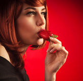 Sexy woman eating strawberry Royalty Free Stock Photos