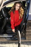 Sexy woman in elegant clothes posing in luxurious car. Fashion outdoor photo of beautiful sexy woman in elegant clothes posing in luxurious car Stock Images