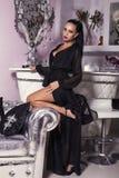 Sexy woman in elegant dress posing in luxury interior Royalty Free Stock Image