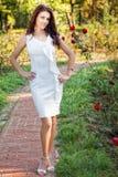 woman in elegant white dress outdoor Stock Photos