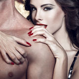 Sexy woman embrace naked man shoulder Royalty Free Stock Photography